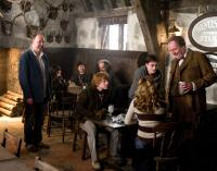 HARRY POTTER AND THE HALF-BLOOD PRINCE, front, from left: director David Yates, Rupert Grint, Emma Watson (from behind), Daniel Radcliffe (standing, second from right), Jim Broadbent, on set, 2009. ph: Jaap Buitendijk/©Warner Bros.