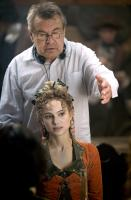 GOYA'S GHOSTS, director Milos Forman (top), Natalie Portman, on set, 2006. ©Warner Bros.