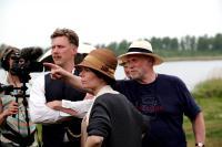 EVERLASTING MOMENTS, (aka MARIA LARSSONS EVIGA OGONBLICK), Mikael Persbrandt (arms folded), director Jan Troell (right), on set, 2008. ©IFC Films