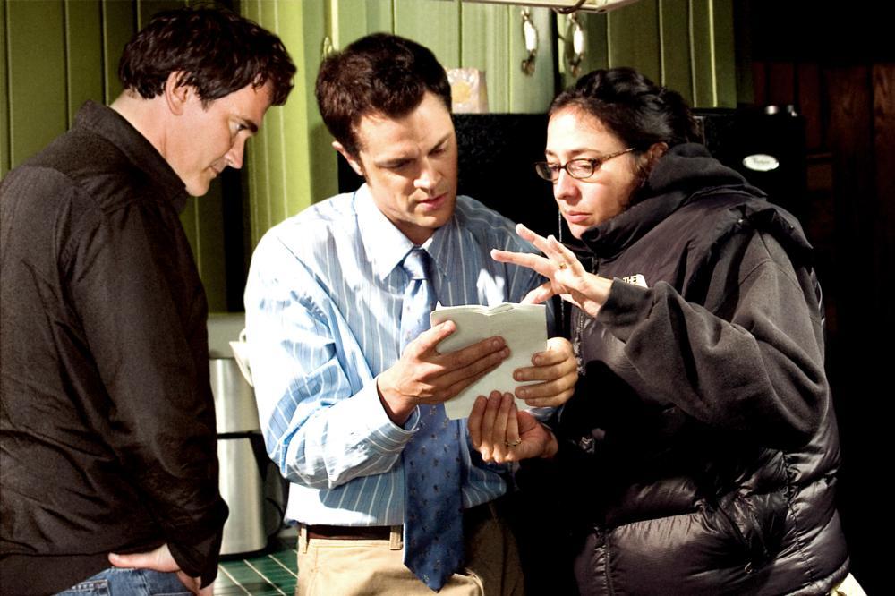 DALTRY CALHOUN, Executive producer Quentin Tarantino, Johnny Knoxville, director Katrina Holden Bronson on set, 2005, (c) Miramax