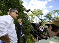CRUDE, Steven Donziger (left), Rainforest Foundation co-founder Trudie Styler (blonde hair, left), director Joe Berlinger (right, with camera), 2009. ph: Sebastian Posingis/©First Run Features