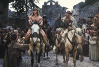 CONAN THE DESTROYER, front horseback from left: Arnold Schwarzenegger, Tracey Walter, 1984, © Universal