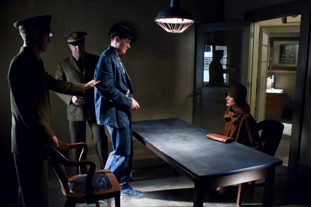 CHANGELING, Jason Butler Harner (standing at table), Angelina Jole (seated right), 2008, © Universal