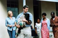 CAPE OF GOOD HOPE, Debbie Brown (far left), Morne Visser(carrying dog), Eriq Ebouaney (far right),  2004, (c) New Yorker Films
