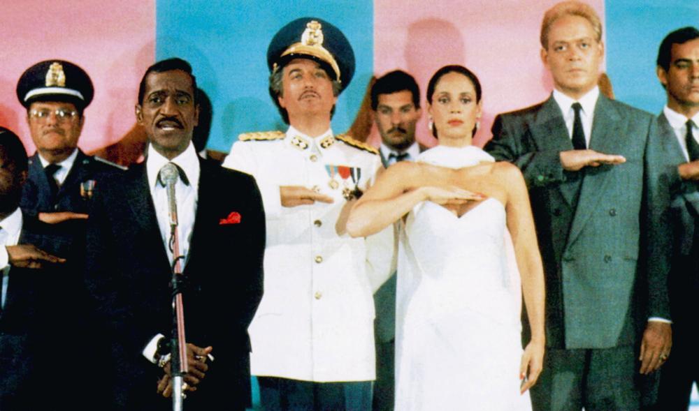 MOON OVER PARADOR, front, from left: Sammy Davis Jr., Richard Dreyfuss, Sonia Braga, Raul Julia, 1988. ©Universal Pictures/Courtesy Everett