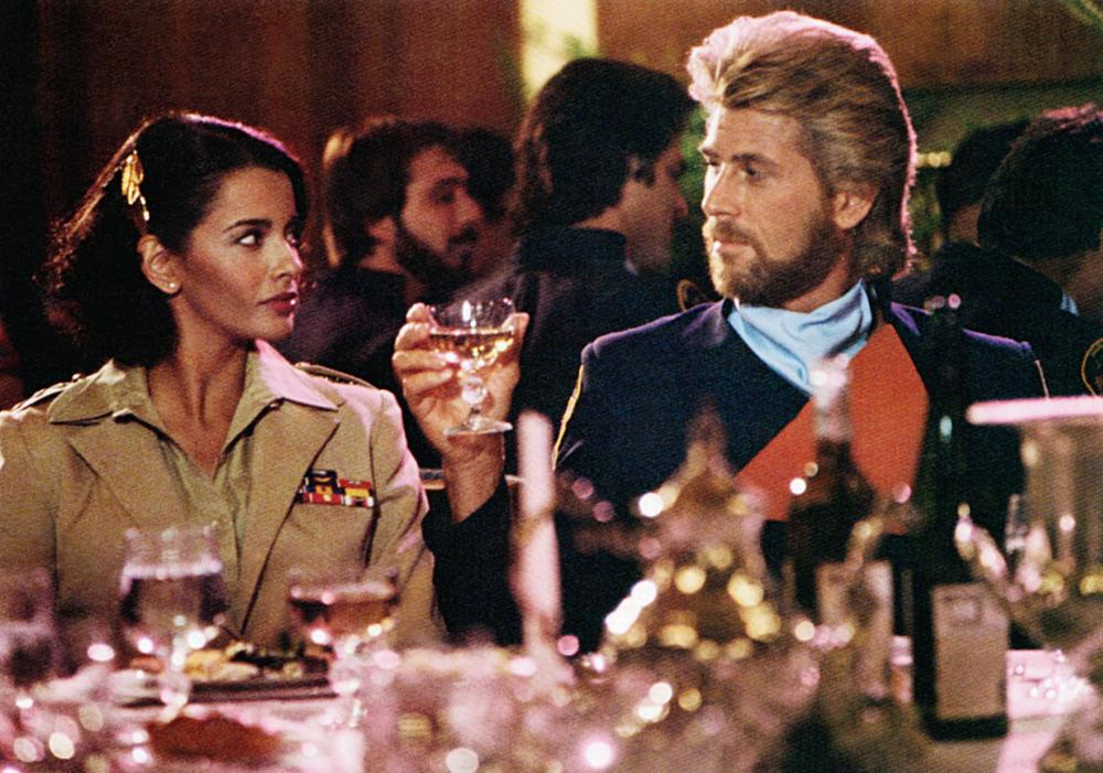 MEGAFORCE, from left: Persis Khambatta, Barry Bostwick, 1982, TM and Copyright ©20th Century Fox Film Corp. All rights reserved.