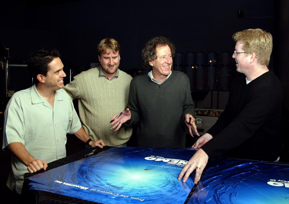 FINDING NEMO, Lee Unkrich, Graham Walters, Geoffrey Rush, Andrew Stanton with the film's poster, 2003, (c) Walt Disney