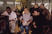 THE ITALIAN JOB, Director F. Gary Gray, producer Donald De Line, Charlize Theron, Mark Wahlberg, Jason Statham watching playback on the set, 2003, (c) Paramount