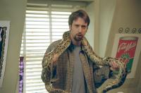 ROAD TRIP, Tom Green, 2000, Holding snake.