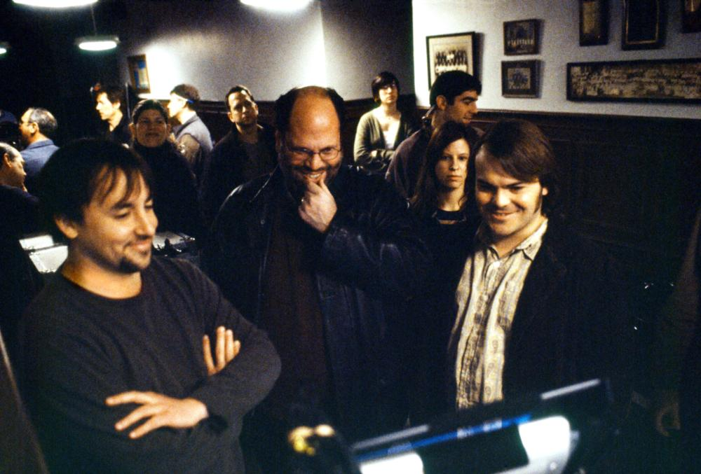SCHOOL OF ROCK, Director Richard Linklater, producer Scott Rudin, Jack Black watching playback on set, 2003, (c) Paramount