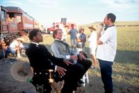 WILD WILD WEST, Director, Barry Sonnenfeld, discusses a scene, with Kevin Kline and Will Smith, on location, 1999.