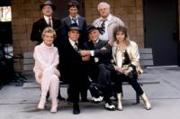 TOUGH GUYS, (standing l-r): Eli Wallach, Dana Carvey, Charles Durning, (seated l-r): Alexis Smith, Burt Lancaster, Kirk Douglas, Darlanne Fluegel, 1986, (c)Buena Vista Pictures
