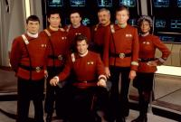 STAR TREK V: THE FINAL FRONTIER, (l-r standing): Leonard Nimoy, George Takei, James Doohan, DeForest Kelley, Nichelle Nichols, (seated front): William Shatner, 1989, (c)Paramount