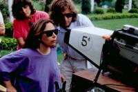 SHE-DEVIL, Director Susan Seidelman (front right), producer Jonathan Brett (right), on set, 1989.TM and Copyright ©20th Century Fox Film Corp. All rights reserved.