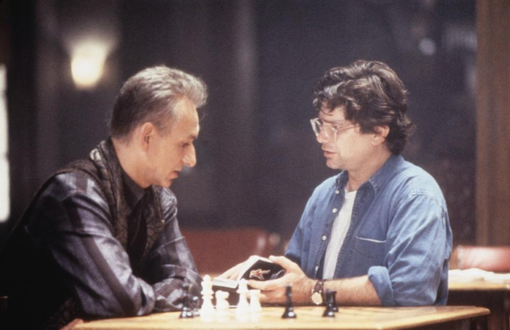 SEARCHING FOR BOBBY FISCHER, from left: Ben Kingsley, director Steven Zaillian on set, 1993, (c) Paramount
