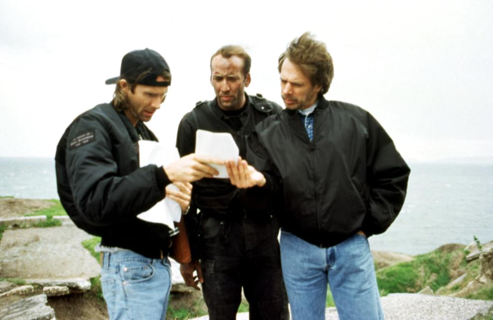 THE ROCK, Director Michael Bay, Nicolas Cage, producer Jerry Bruckheimer on set, 1996(c) Buena Vista Pictures.