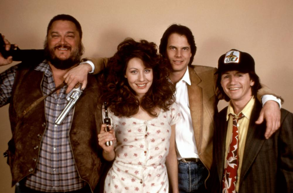 PASS THE AMMO, Dennis Burkley (far left), Linda Kozlowski (second from left), Bill Paxton (third from left), 1988. ©New Century Vista Film