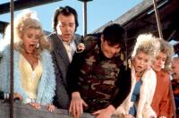 MILLION DOLLAR MYSTERY, Rick Overton (second from left), Rich Hall (center), 1987, (c)De Laurentiis Entertainment Group