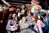 MILLION DOLLAR MYSTERY, Eddie Deezen (standing left), Mona Lyden (standing second from left), Douglas Emerson (standing 3rd from left), Rick Overton (standing 4th from left), Tom Bosley (center), 1987, (c)De Laurentiis Entertainment Group