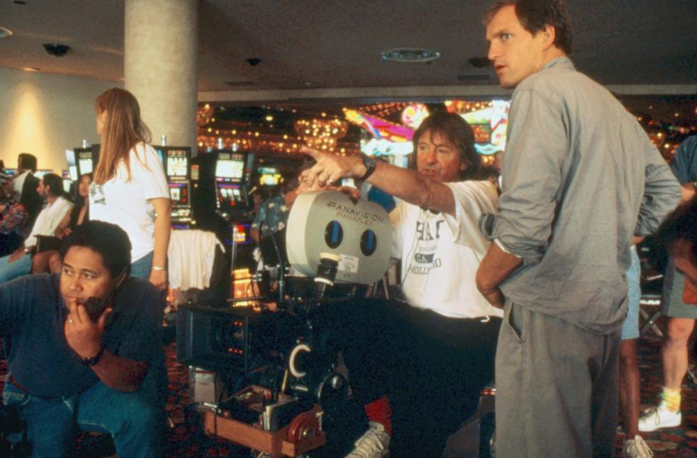INDECENT PROPOSAL, director Adrian Lyne (center), on set, Woody Harrelson (right), 1993. ©Paramount