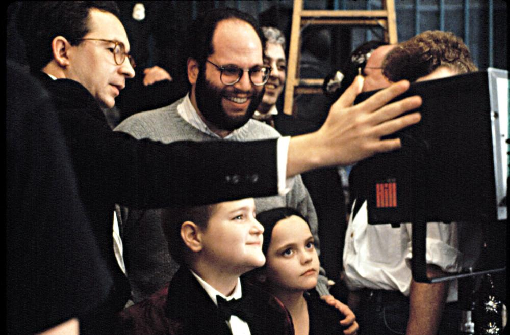 THE ADDAMS FAMILY, Director, Barry Sonnenfeld, Producer, Scott Rudin, watch a scene on the monitor with Christina Ricci and Jimmy Workman, 1991.