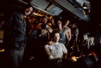 THE ABYSS, (l-r): Capt. Kidd Brewer Jr., Ed Harris (3rd from left), Leo Burmester, John Bedford Lloyd, Kimberly Scott, Todd Graff (seated front), 1989, TM and Copyright (c)20th Century Fox Film Corp. All rights reserved.
