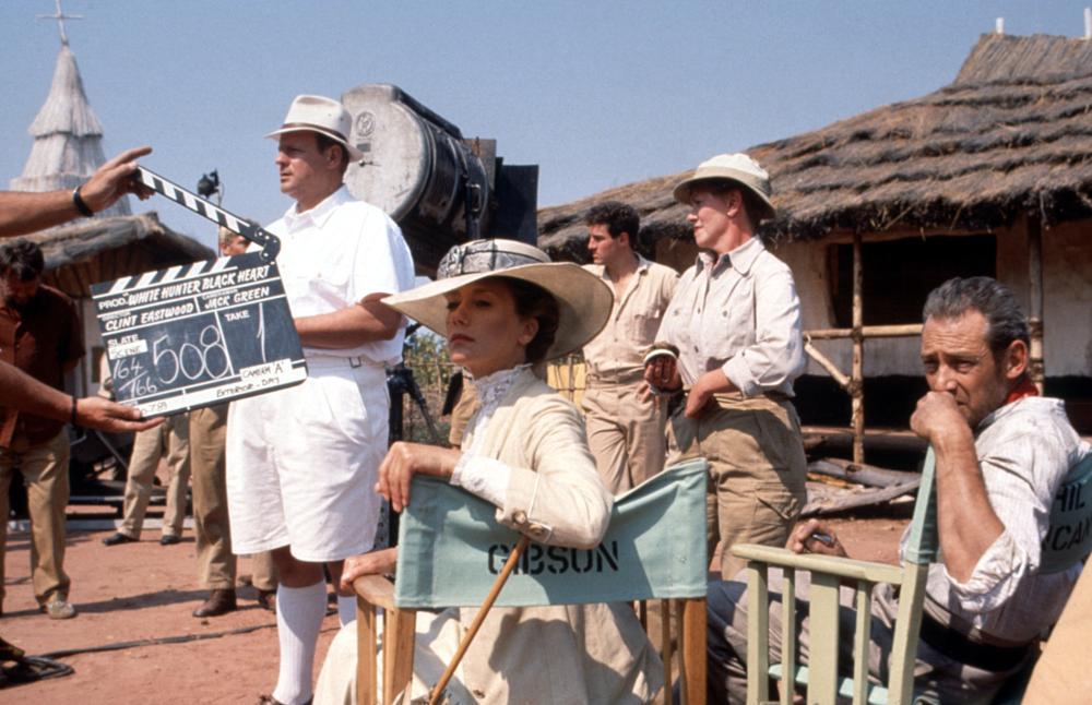 WHITE HUNTER BLACK HEART, George Dzundza (far left) and cast on set, 1990, (c)Warner Bros