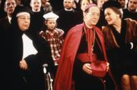 THE DIVINE RYANS, Pete Postlethwaite (left rear), Marguerite McNeil (nun), Genevieve Tessier (plaid coat), Michael Chiasson (bishop), Mary Walsh, 1999, © Red Sky Entertainment