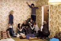SOUL KITCHEN, Dorka Gryllus (seated far left), Adam Bousdoukos (on floor), director Fatih Akin (top), on set, 2009. ©Pandora