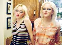 THE RUNAWAYS, from left: Dakota Fanning as Cherie Currie, Riley Keough, 2010. ©Apparition