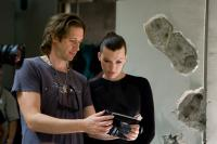 RESIDENT EVIL: AFTERLIFE, from left: director  Paul W.S. Anderson, Milla Jovovich, on set, 2010. ph: Rafy/©Screen Gems