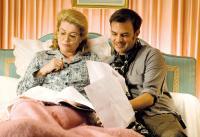 POTICHE, from left: Catherine Deneuve, director Francois Ozon, on set, 2010. ©Mars Distribution