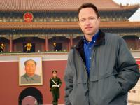 THE NATURE OF EXISTENCE, Roger Nygard at Tiananmen Square, with the portrait of General Mao in background, 2010, ©Walking Shadows