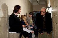 LET ME IN, director Matt Reeves (left), Chloe Moretz (second from right), Richard Jenkins (right), on set, 2010. Ph: Saeed Adyani/©Overture Films