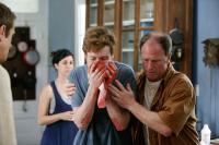 THE LAST EXORCISM, from left: Iris Bahr, Caleb Landry Jones, Louis Herthum, 2010. ph: Patti Perret/©Lionsgate