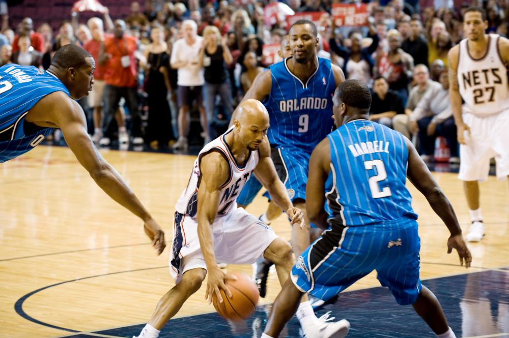JUST WRIGHT, foreground l-r: Dwight Howard, Common, 2010, photo: David Lee/TM and Copyright ©Fox Searchlight Pictures. All rights reserved.