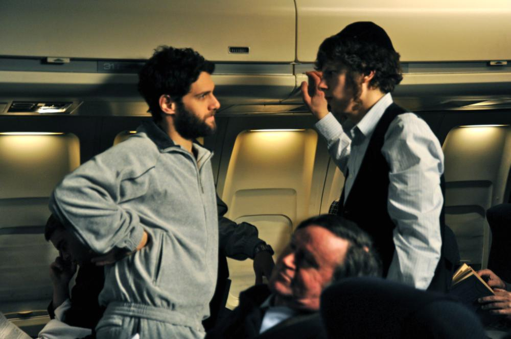 HOLY ROLLERS, from left: Justin Bartha, Jesse Eisenberg, 2010. ©First Independent Pictures