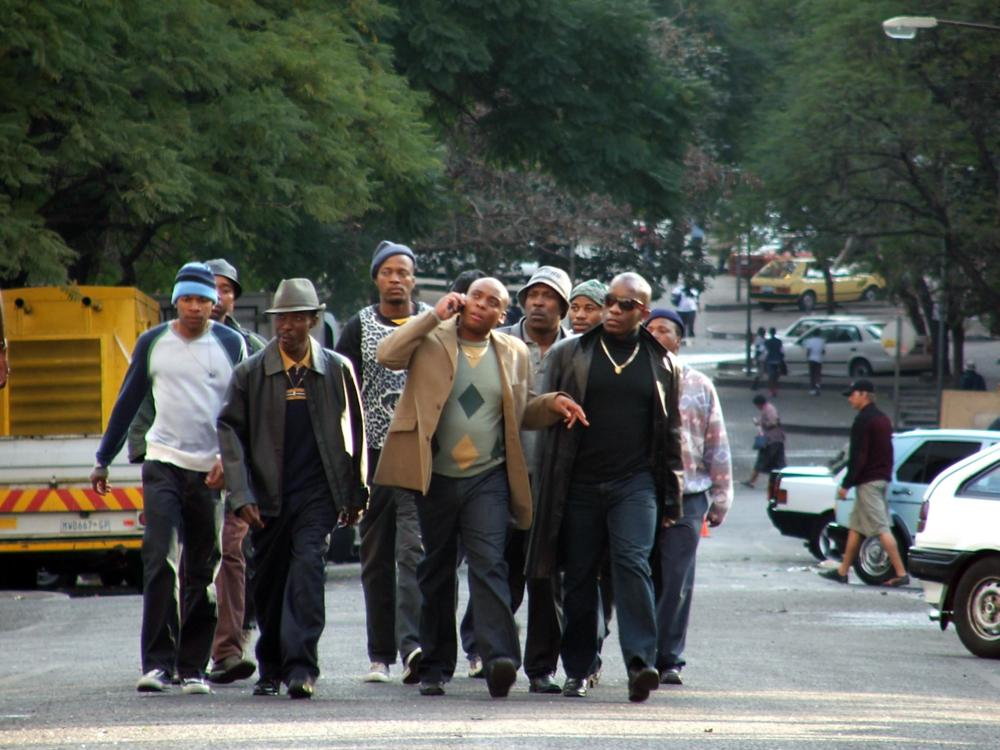 GANGSTER'S PARADISE: JERUSALEMA, (aka JERUSALEMA), Ronnie Nyakale (front, second from left), Rapulana Seiphemo (center), Patrick Mofokeng (right of center, with hat), Jeffrey Sekele (front right), 2008. ph: Jonathan Burger/©Anchor Bay Entertainment