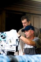EDGE OF DARKNESS, director Martin Campbell (back), Mel Gibson, on set, 2010. ph: Macall Polay/©Warner Bros. Pictures