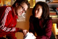 DEFENDOR, from left: writer/director Peter Stebbings, Sandra Oh, on set, 2009. ©Sony Pictures