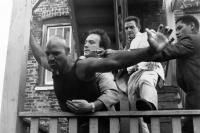 RED HEAT, James Belushi (center), Richard Bright (second from right), Laurence Fishburne (right), 1988. © Columbia Pictures