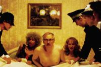 PERSONAL SERVICES, Benjamin Whitrow (in bed center), 1987, © Vestron