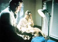 THE HOWLING, Patrick MacNee (left), Dee Wallace (rear), Christopher Stone (lying down), 1981, © Avco Embassy