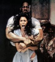 EXTREME PREJUDICE, front to back: Maria Conchita Alonso, Tommy 'Tiny' Lister, 1987. ©TriStar Pictures