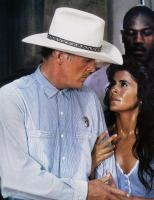 EXTREME PREJUDICE, left to right: Nick Nolte, Maria Conchita Alonso, Tommy 'Tiny' Lister (back), 1987. ©TriStar Pictures