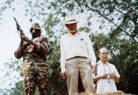BABY: SECRET OF THE LOST LEGEND, from left: Olu Jacobs, Patrick McGoohan, Julian Fellowes, 1985. ©Buena Vista Pictures