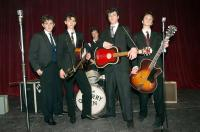 NOWHERE BOY, Thomas Sangster as Paul McCartney (second from left), Aaron Johnson as John Lennon (red guitar), 2009. ph: Liam Daniel/©Weinstein Company