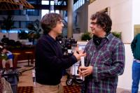 CEDAR RAPIDS, from left: producer Alexander Payne, director Miguel Arteta, on set, 2011. ph: Zade Rosenthal/TM and Copyright ©Fox Searchlight Pictures. All rights reserved.