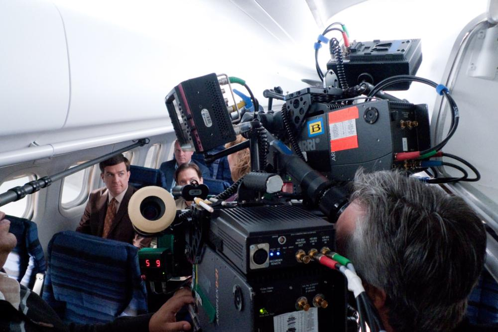 CEDAR RAPIDS, Ed Helms (left), on set, 2011. ph: Zade Rosenthal/TM and Copyright ©Fox Searchlight Pictures. All rights reserved.