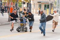 ABDUCTION, center: Taylor Lautner, 2nd from right: John Singleton on set, 2011, ph: Bruce Talamon/©Lionsgate